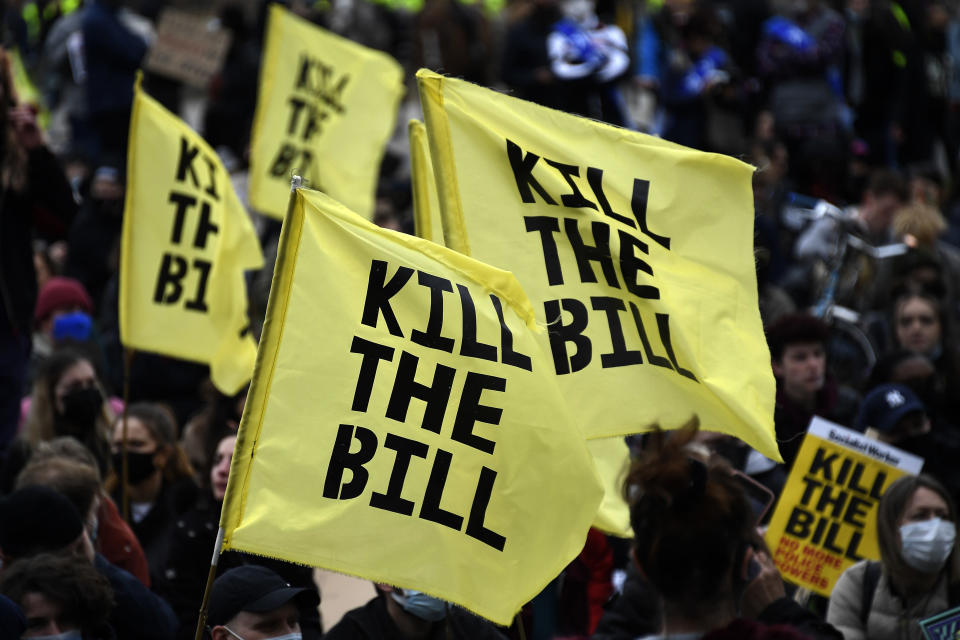 Demonstrators hold flags during a 'Kill the Bill' protest in London, Saturday, April 3, 2021. The demonstration is against the contentious Police, Crime, Sentencing and Courts Bill, which is currently going through Parliament and would give police stronger powers to restrict protests. (AP Photo/Alberto Pezzali)