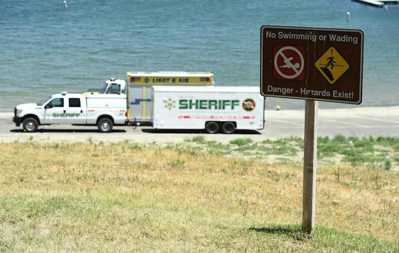 A sign warns of safety hazards as members of the Ventura County Sheriff's Underwater Search and Rescue Team search Thursday for former 'Glee' actor Naya Rivera in Lake Piru, in Southern California. (Photo: ASSOCIATED PRESS)