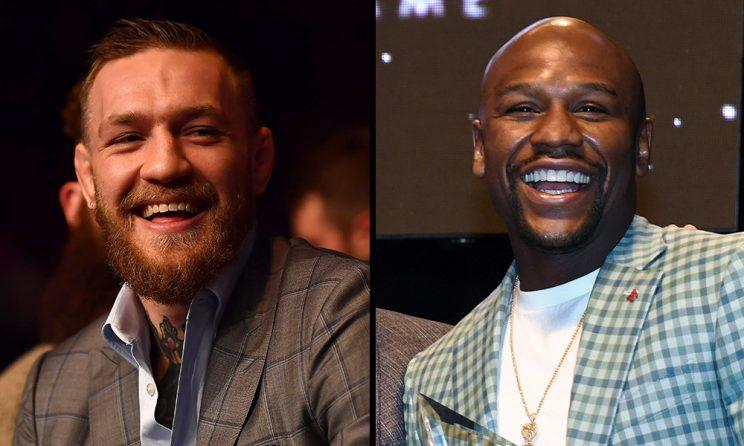 Conor McGregor (L) and Floyd Mayweather both stand to make upwards of $100 million for their fight. (Getty)
