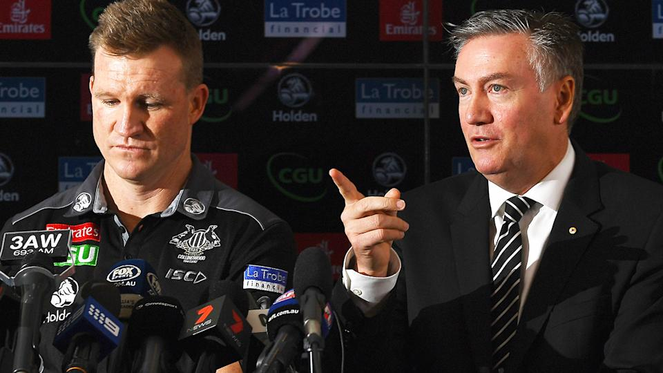 Nathan Buckley and Eddie McGuire are pictured side by side during a Collingwood Magpies press conference.