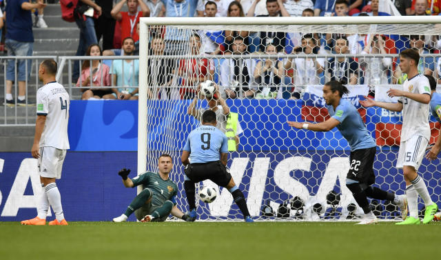 Russia goalkeeper Igor Akinfeev reacts as the ball slips past him into the net for an own goal and Uruguay's second goal during the group A match between Uruguay and Russia at the 2018 soccer World Cup at the Samara Arena in Samara, Russia, Monday, June 25, 2018. (AP Photo/Martin Meissner)