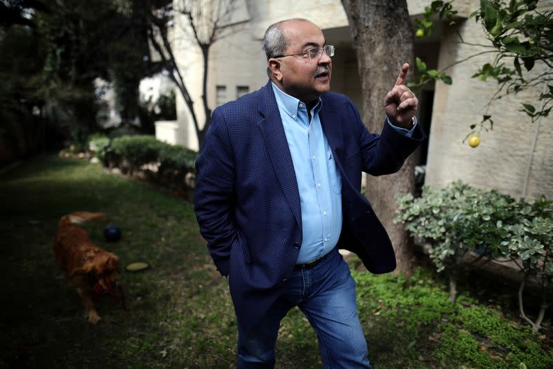 Arab politician Ahmad Tibi, of the Joint List party, gestures during his interview with Reuters at his house in East Jerusalem