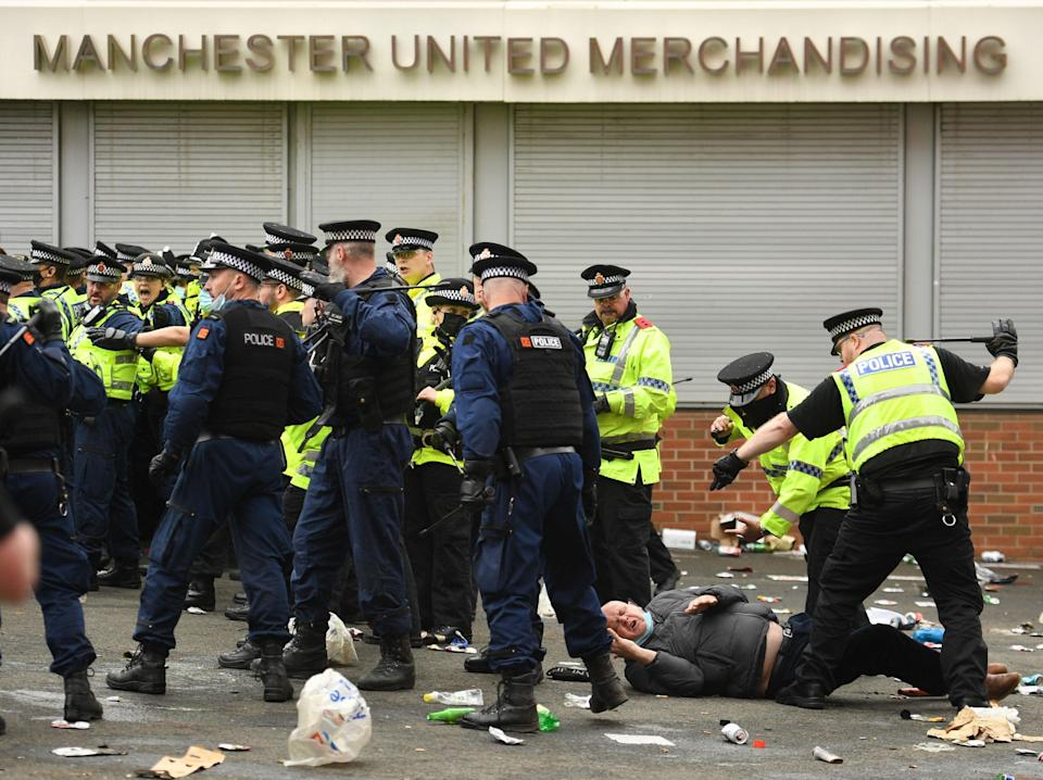 Police attempt to manage the situation outside Old TraffordAFP via Getty Images