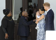 FILE - In this Sept. 25, 2019, file photo, Britain's Prince Harry and Meghan, Duchess of Sussex, holding their son Archie, meet Anglican Archbishop Emeritus, Desmond Tutu and his wife Leah in Cape Town, South Africa. Almost as soon as Meghan and Prince Harry's interview with Oprah Winfrey aired, many were quick to deny Meghan's allegations of racism on social media. Many say it was painful to watch Meghan's experiences with racism invalidated by the royal family, members of the media and the public, offering up yet another example of a Black woman's experience being disregarded and denied. (Henk Kruger/Pool via AP, File)