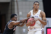 Lamar guard Ellis Jefferson, left, attempts to strip the ball from Abilene Christian forward Joe Pleasant, right, during the second half of an NCAA college basketball game in the Southland Conference semifinals Friday, March 12, 2021, in Katy, Texas. (AP Photo/Michael Wyke)
