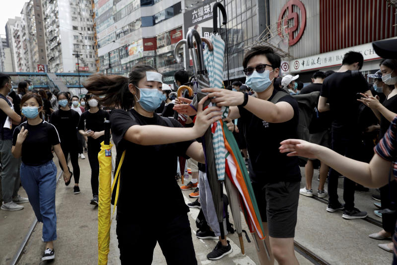 Image result for Hong Kong protests: Police fire tear gas near China's liaison office