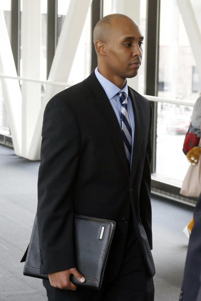 CORRECTS TO APRIL 25, 2019-Mohamed Noor, the former Minneapolis police officer, follows behind his attorneys as he arrives at the Hennepin County Government Center Thursday, April, 25, 2019 in Minneapolis in the fourth week of his trial. Noor is charged with second-degree intentional murder, third-degree murder and second-degree manslaughter in the July 15, 2017, shooting death of Justine Ruszczyk Damond, a 40-year-old life coach and Australian-American who had called 911 to report a possible sexual assault behind her home. (AP Photo/Jim Mone)