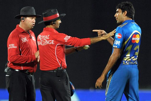 Mumbai Indians bowler Munaf Patel (R) argues with umpires about the wicket of Deccan Chargers captain Kumar Sangakkara during the IPL Twenty20 cricket match between Deccan Chargers and Mumbai Indians at Dr. Y.S. Rajasekhara Reddy Cricket Stadium in Visakhapatnam on April 9, 2012. AFP PHOTO / Noah SEELAM (Photo credit should read NOAH SEELAM/AFP/Getty Images)