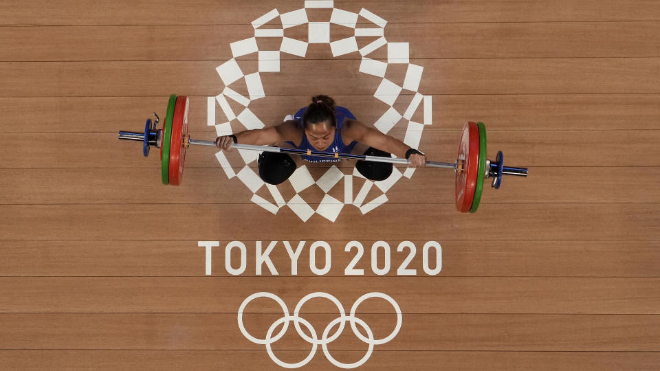 Hidilyn Diaz of Philippines competes in the women's 55kg weightlifting event at the 2020 Tokyo Olympics.