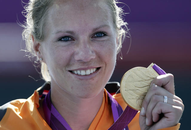 Esther Vergeer of the Netherlands holds her gold medal for winning the women's wheelchair tennis final at the 2012 Paralympics games, Friday, Sept. 7, 2012, in London. Vergeer defeated Aniek Van Koot in the final 6-0, 6-4.(AP Photo/Alastair Grant)