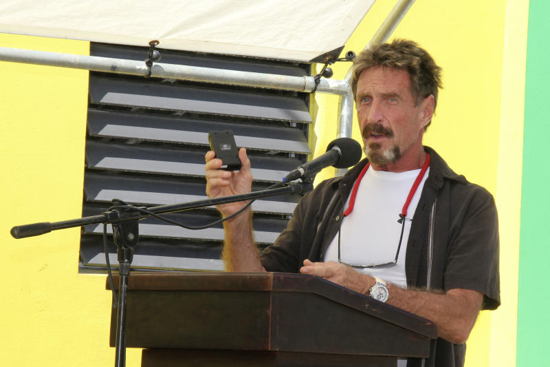 "In this Thursday Nov. 8, 2012 photo software company founder John McAfee speaks at the official presentation of equipment ceremony that took place at the San Pedro Police Station in Ambergris Caye, Belize. McAfee, 67, has been identified as a ""person of interest"" in the killing of his neighbor, 52-year-old Gregory Viant Faull, whose body was found on Sunday. Police are urging McAffe to come in for questioning. (AP Photo/Ambergris Today Online-Sofia Munoz)"