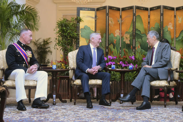 Singapore's Prime Minister Lee Hsien Loong, right, meets U.S. Defense Secretary Jim Mattis, center, and Joint Chiefs Chairman Gen. Joseph Dunford Jr., left, at the presidential palace in Singapore, June 2, 2017. (Photo: Joseph Nair/AP)