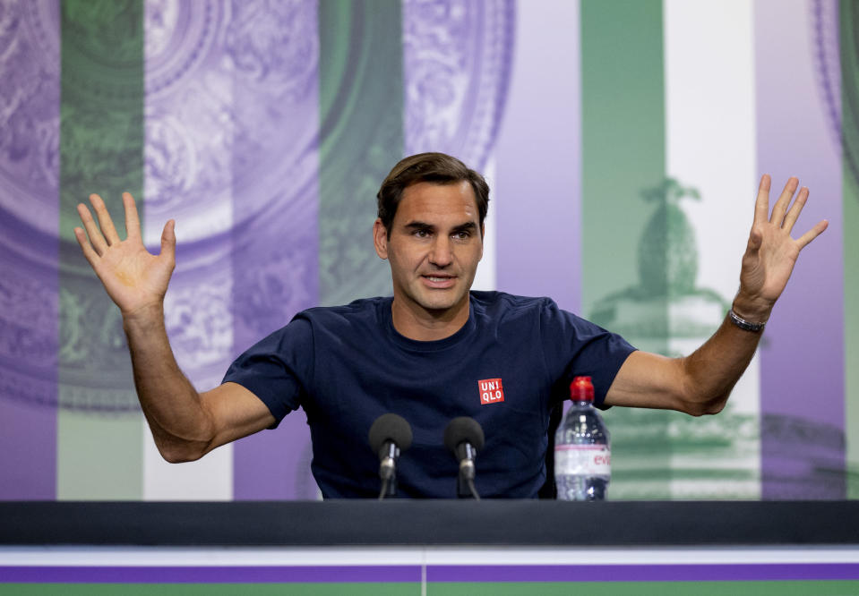 Switzerland's Roger Federer attends a press conference prior to the Wimbledon Tennis Championships in London, Saturday June 26, 2021. (Florian Eisele/Pool via AP)