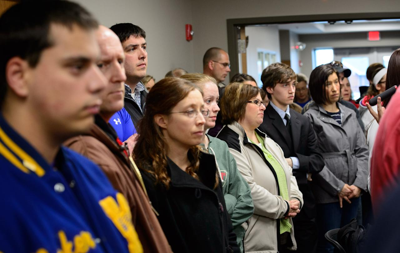 "Students, parents and community members stand in the back of the room to listen as Waseca Police Captain Kris Markeson and Waseca school Superintendent Tom Lee speak at a news conference about the 17-year-old arrested in plot to kill family and massacre students at Waseca school. Authorities said Thursday, May 1, 2014, that they prevented an ""unimaginable tragedy"" by foiling a teenager's elaborate plot to kill his family and bomb the junior and senior high school in the southern Minnesota city of Waseca. (AP Photo/The Star Tribune,Glen Stubbe)"