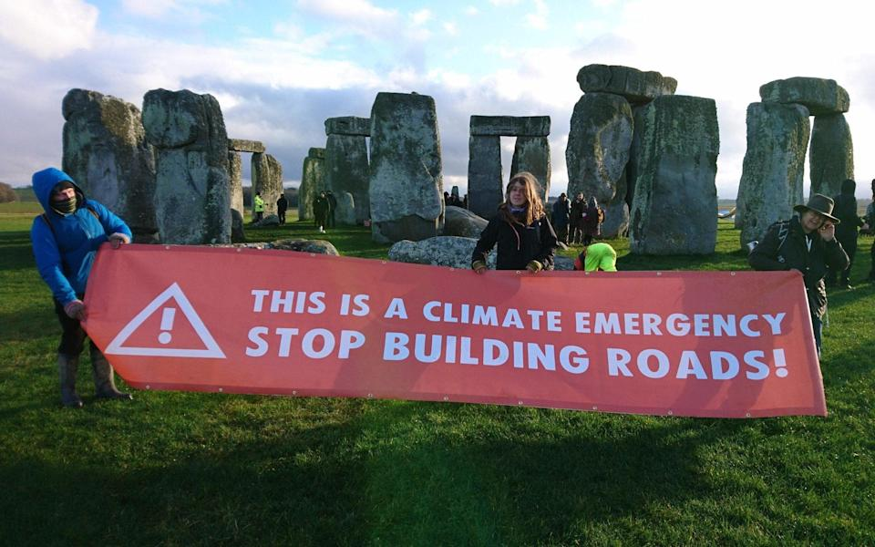Extinction Rebellion protesters joined the demonstration at Stonehenge on Saturday - TWITTER