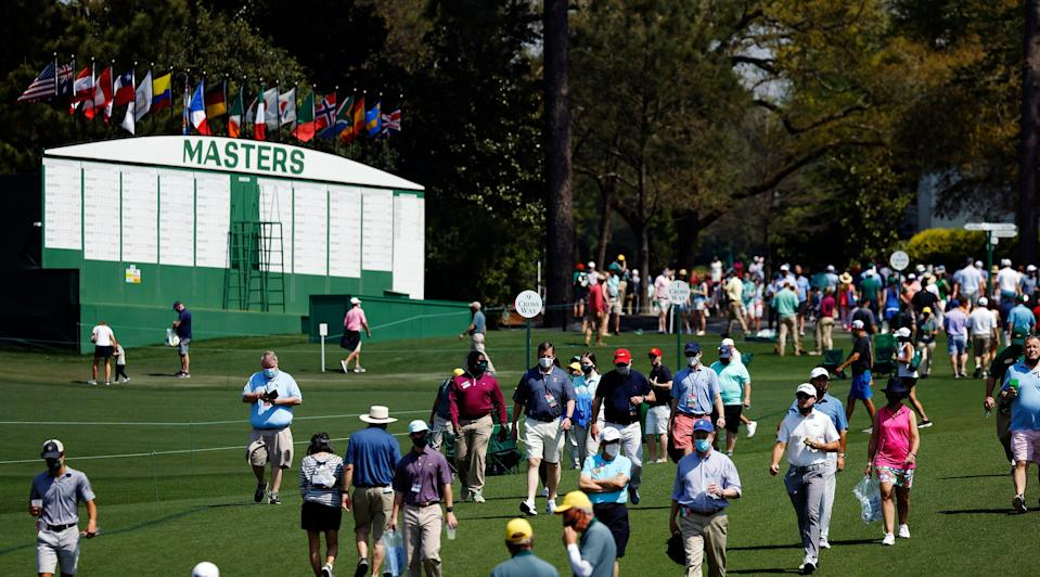 Patrons make the No. 1 and No. 9 fairways during Wednesday's practice round for the Masters.