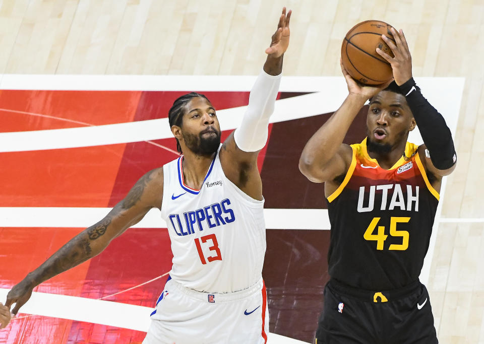 SALT LAKE CITY, UTAH - JUNE 10: Donovan Mitchell #45 of the Utah Jazz shoots over Paul George #13 of the LA Clippers in Game Two of the Western Conference second-round playoff series at Vivint Smart Home Arena on June 10, 2021 in Salt Lake City, Utah. NOTE TO USER: User expressly acknowledges and agrees that, by downloading and/or using this photograph, user is consenting to the terms and conditions of the Getty Images License Agreement. (Photo by Alex Goodlett/Getty Images)