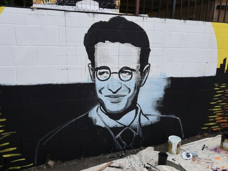 A partially completed portrait by artist Levi Ponce for his Memorial Day mural project of murdered journalist Daniel Pearl, near his old neigborhood in Los Angeles, California in 2015