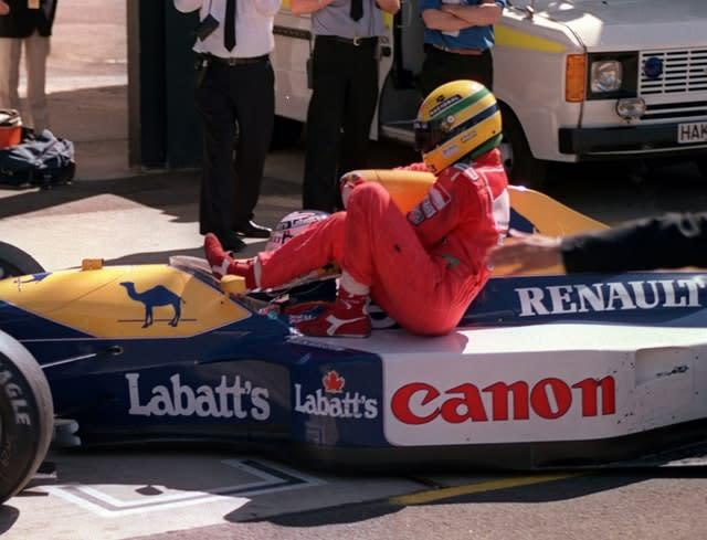 Senna hitches a ride on Mansell's Williams Renault after he ran out of fuel on the last lap of the British Grand Prix at Silverstone (David Jones/PA)