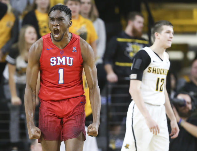"SMU guard <a class=""link rapid-noclick-resp"" href=""/ncaab/players/131164/"" data-ylk=""slk:Shake Milton"">Shake Milton</a> celebrates a shot and a foul while Wichita State guard <a class=""link rapid-noclick-resp"" href=""/ncaab/players/136718/"" data-ylk=""slk:Austin Reaves"">Austin Reaves</a> can only watch during the second half of an NCAA college basketball game, Wednesday, Jan. 17, 2018 in Wichita, Kan. (Travis Heying/The Wichita Eagle via AP)"
