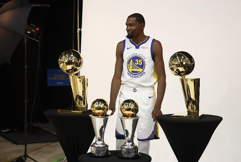 f17d050dffef Golden State Warriors star Kevin Durant poses with two Larry O  39 Brien NBA