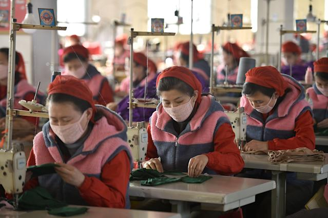 Workers at the Songyo Knitwear Factory in Pyongyang, North Korea, produce masks for protection against the coronavirus (AFP via Getty)