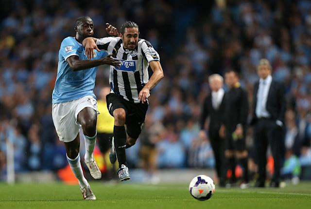 Newcastle United's Jonas Gutierrez (right) and Manchester City's Yaya Toure battle for the ball