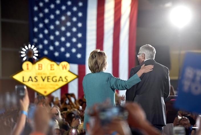 Hillary Clinton and Harry Reid address the International Brotherhood of Electrical Workers in Las Vegas, Aug. 4, 2016. (Photo: David Becker/Getty Images)