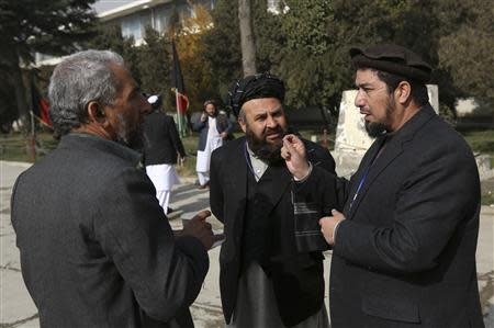 Members of the Loya Jirga, or grand council, talk about a committee session in Kabul November 22, 2013. REUTERS/Omar Sobhani