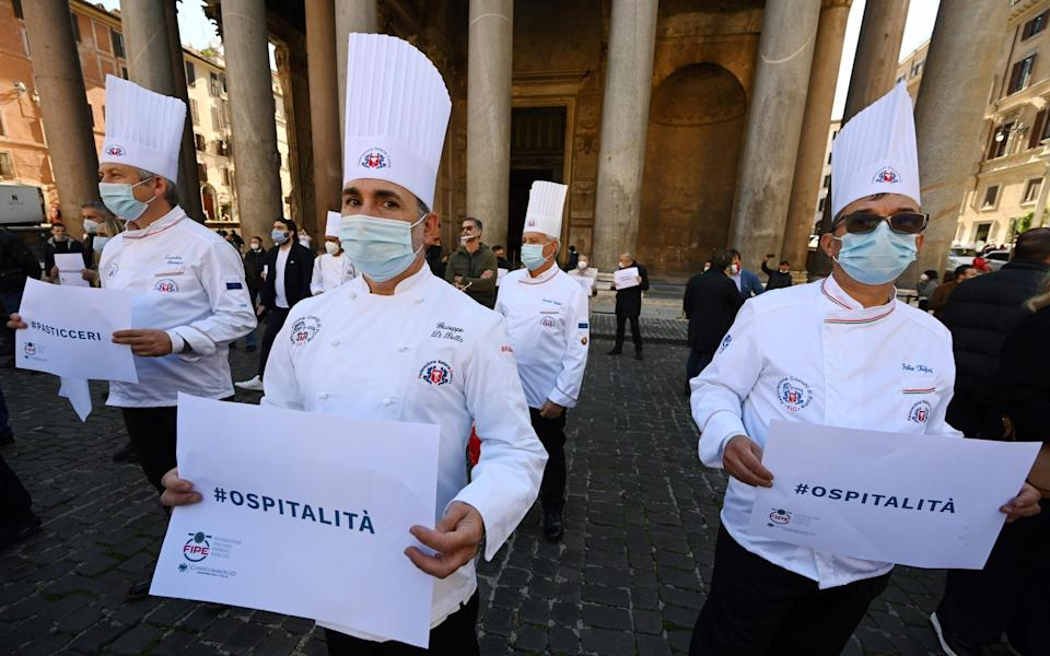 Italian chefs join the protests against lockdown restrictions in Rome's Pantheon Square - Getty