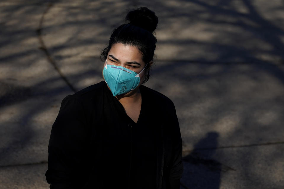 Lily Guido poses for photos in Sebastopol, Calif., Monday, Dec. 21, 2020. Taxpayers in families that include immigrants in the country illegally are celebrating the December federal relief bill after being excluded from the April relief stimulus. (AP Photo/Jeff Chiu)