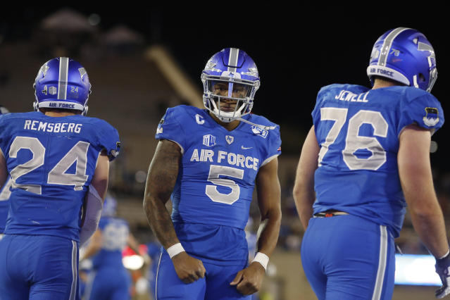 Air Force quarterback Donald Hammond III, center, celebrates his touchdown, between running back Kadin Remsberg, left, and offensive lineman Adam Jewell during the second half of an NCAA college football game against Fresno State on Saturday, Oct. 12, 2019, at Air Force Academy, Colo. (AP Photo/David Zalubowski)