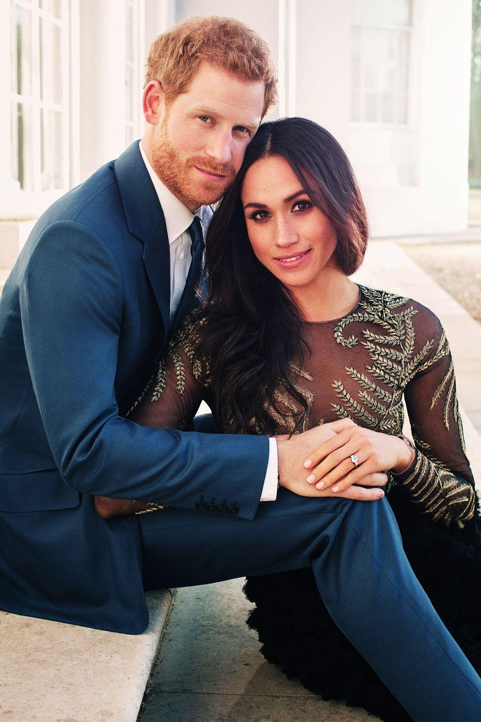 <p>Meghan and Harry sit close during an official engagement photo shoot.</p>