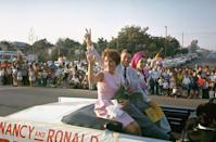 <p>In late 1965, Ronald Reagan announced his run for governor of California. Here, he and Nancy were photographed riding in a convertible while on the campaign trail. </p>