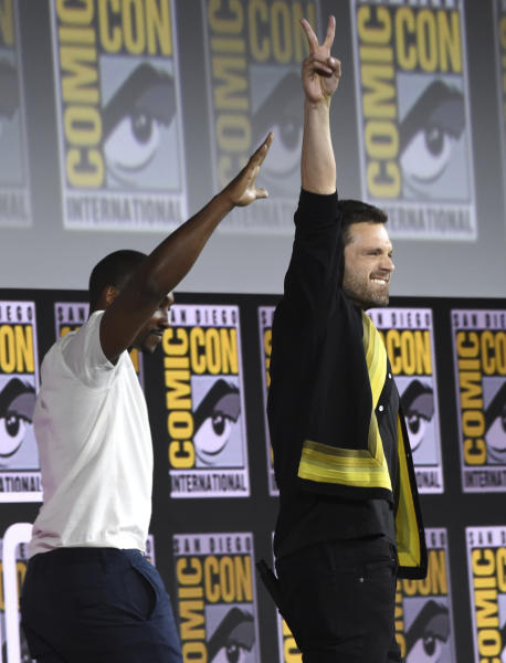 Sebastian Stan, left, and Anthony Mackie gesture to the audience at the Marvel Studios panel on day three of Comic-Con International on Saturday, July 20, 2019, in San Diego. (Photo by Chris Pizzello/Invision/AP)