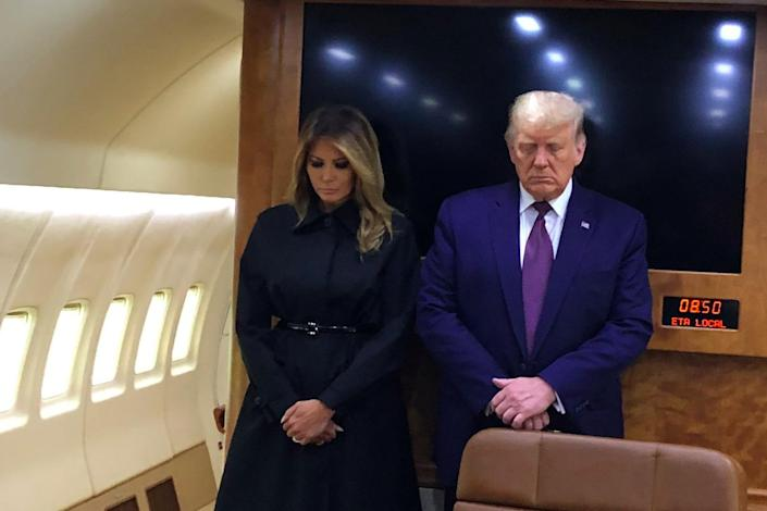 First lady Melania Trump and President Trump observe a moment of silence on Air Force One in honor of 9/11 victims on Friday. (Via White House press pool)