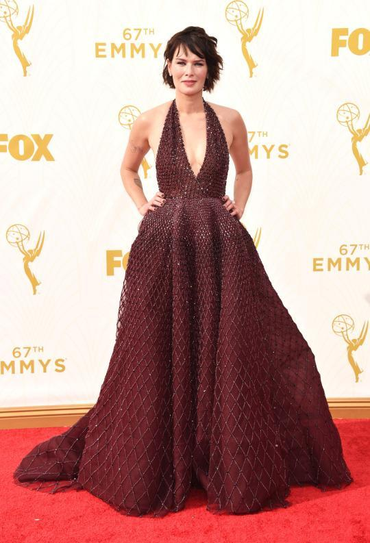 """<p>Lena Headey's famous scene in """"Game of Thrones"""" had her taking it all off and therefore it wouldn't have been surprising if she'd worn a naked gown a la Jennifer Lopez and Beyoncé. But instead she went the couture route and chose a berry red Zuhair Murad dress from the Fall 2015 collection. Never has covering up looked so good. </p>"""