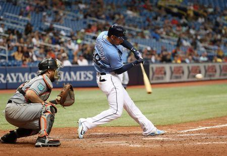 Jul 22, 2018; St. Petersburg, FL, USA; Tampa Bay Rays third baseman Daniel Robertson (28) hits a walk off grand slam during the ninth inning against the Miami Marlins at Tropicana Field. Mandatory Credit: Kim Klement-USA TODAY Sports