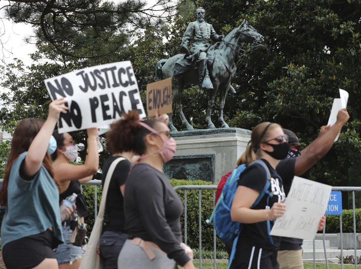 Hundreds of protesters march past the bronze statue of John Brown Gordon in full Confederate regalia atop his horse Marye at the Capitol Building shouting for it to be taken down following the Atlanta police shooting death of Rayshard Brooks outside of Wendy's and the death of George Floyd at the hands of Minneapolis police officers. (Curtis Compton /Atlanta Journal-Constitution via AP)