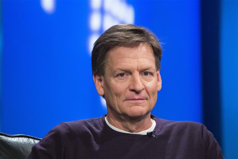"Author Michael Lewis smiles during an interview at Reuters regarding his book about high-frequency trading (HFT) named ""Flash Boys: A Wall Street Revolt,"" in New York"