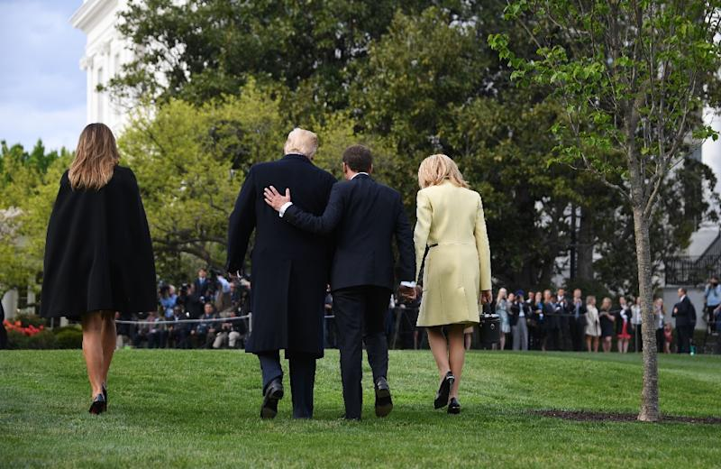 US President Donald Trump and First Lady Melania Trump walk after a tree planting ceremony with French President Emmanuel Macron and his wife Brigitte Macron on the South Lawn of the White House (AFP Photo/JIM WATSON)