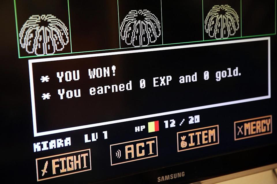 """A screen with images and words, including """"You won!"""""""