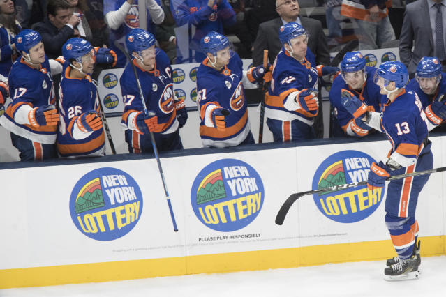 New York Islanders center Mathew Barzal (13) celebrates after scoring the winning goal during a shootout of an NHL hockey game against the Detroit Red Wings, Saturday, Dec. 15, 2018, in Uniondale, N.Y. (AP Photo/Mary Altaffer)