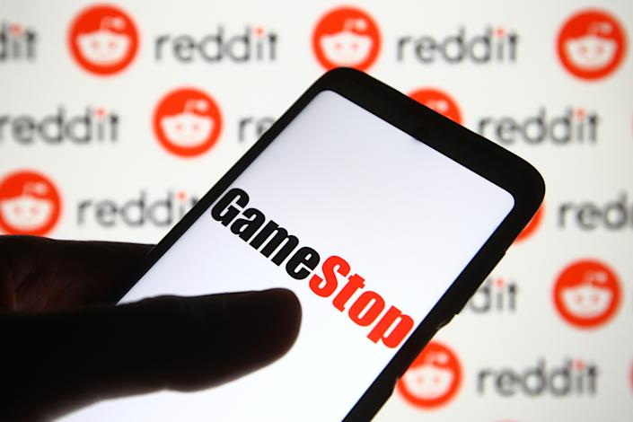 UKRAINE - 2021/02/05: In this photo illustration a GameStop logo is seen on a mobile phone screen in front of Reddit logo. (Photo Illustration by Pavlo Gonchar/SOPA Images/LightRocket via Getty Images)