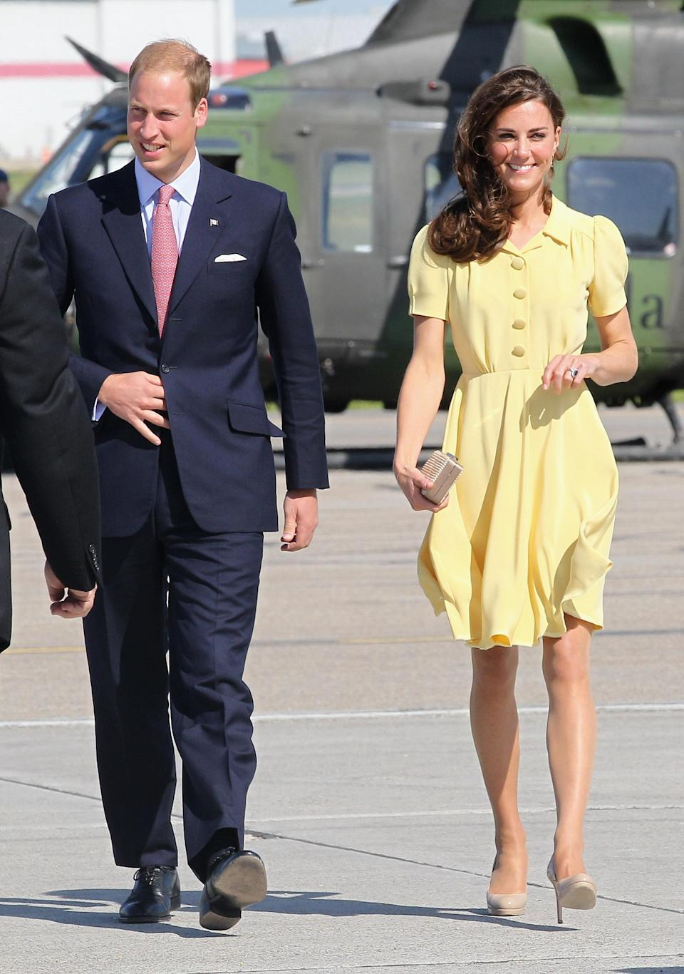 <p>The Duchess of Cambridge touched down in Calgary in style thanks to a punchy yellow dress by Jenny Packham. The Canadian pitstop marked their eighth day of their first overseas tour. [Photo: Getty] </p>