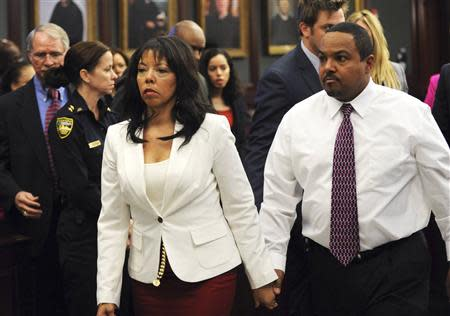 Jordan Davis' mother, Lucia McBath leaves the courtroom with her husband Curtis McBath as court recessed for the jury to reconsider the first charge against Michael Dunn in Jacksonville