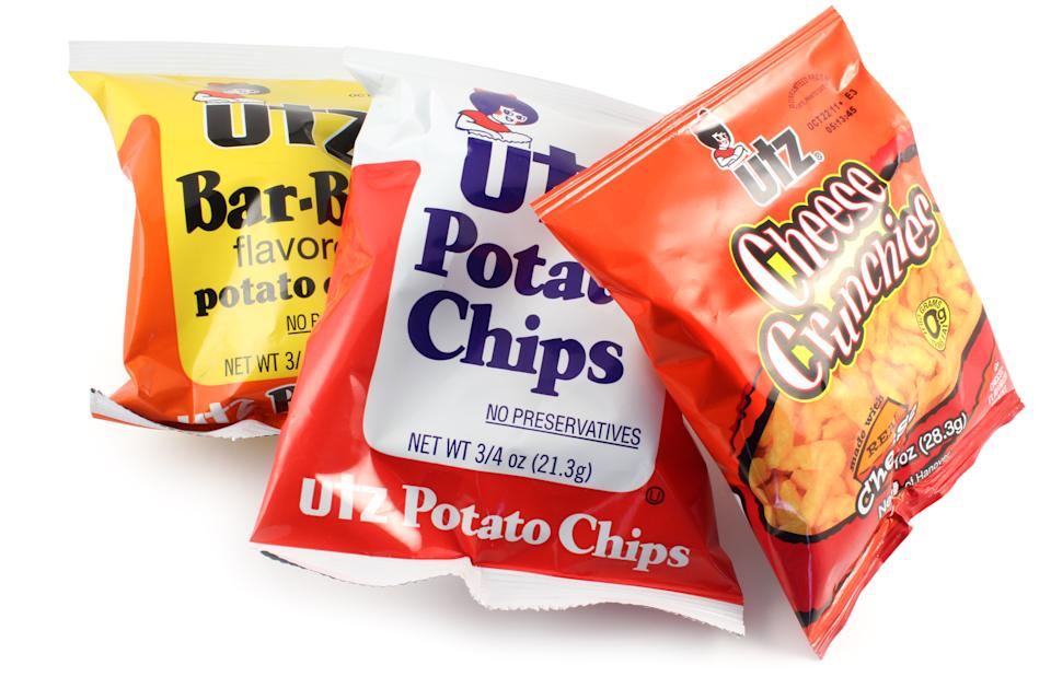 Quakertown, Pennsylvania, United States - September 07, 2011. Utz snacks isolated on a white background. Cheese crunchies, bar-b-q potato chips and plain potato chips.