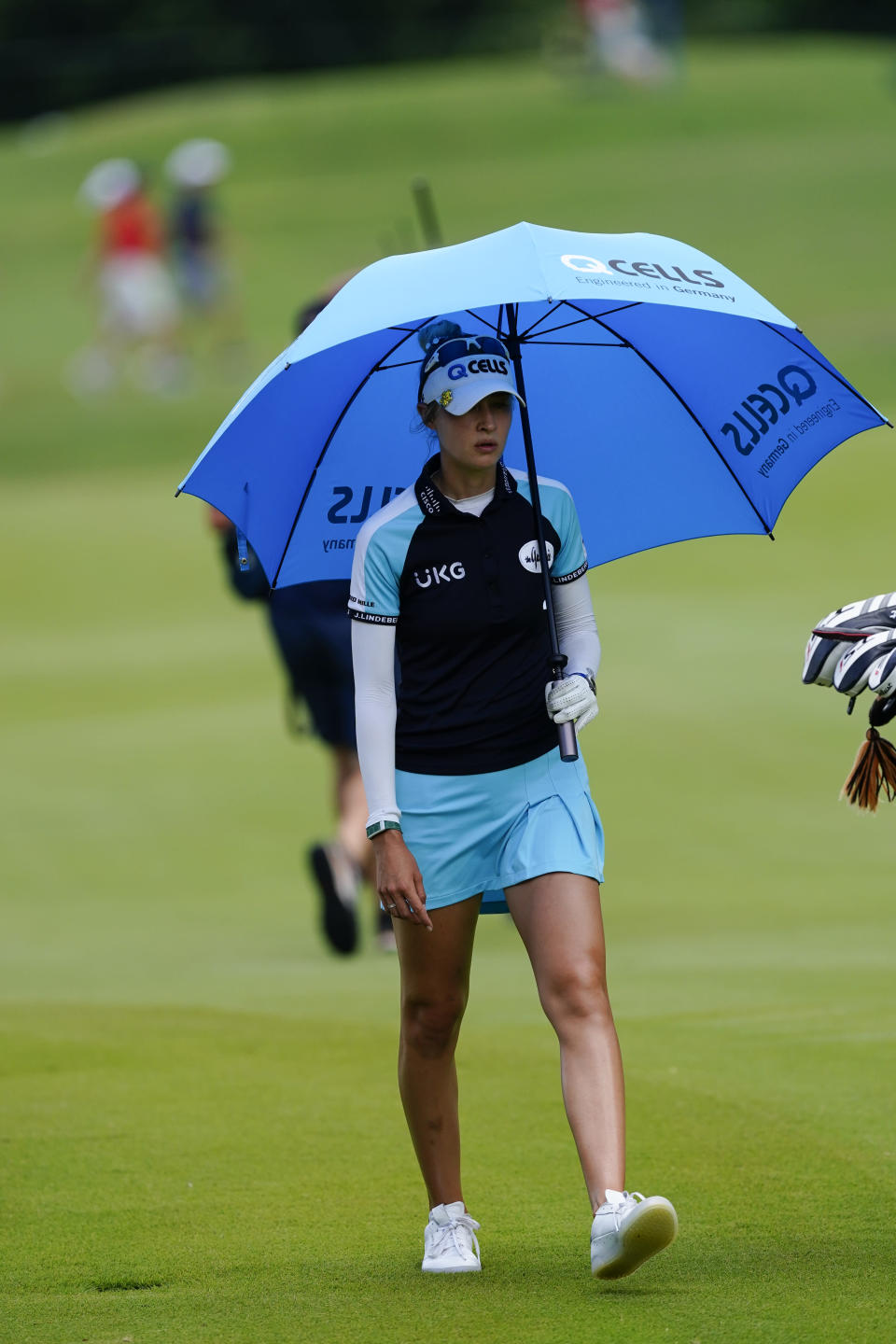 Nelly Korda of the U.S. paces off the distance on the fairway of the second hole, during the final round of play in the KPMG Women's PGA Championship golf tournament Sunday, June 27, 2021, in Johns Creek, Ga. (AP Photo/John Bazemore)