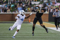 Wake Forest wide receiver Sage Surratt (14) catches a pass next to North Carolina defensive back Trey Morrison during the first half of an NCAA college football game in Winston-Salem, N.C., Friday, Sept. 13, 2019. (AP Photo/Nell Redmond)
