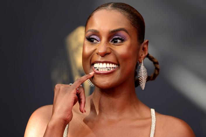 """<p><a href=""""https://people.com/tag/issa-rae/"""" rel=""""nofollow noopener"""" target=""""_blank"""" data-ylk=""""slk:Issa Rae's"""" class=""""link rapid-noclick-resp"""">Issa Rae's</a> dress """"felt like a nod to the '70s,"""" says makeup artist<a href=""""https://www.instagram.com/joannasimkin/"""" rel=""""nofollow noopener"""" target=""""_blank"""" data-ylk=""""slk:Joanna Simkin"""" class=""""link rapid-noclick-resp""""> Joanna Simkin</a>. So, the pro created a """"disco glam"""" look to match using a <a href=""""https://www.elfcosmetics.com/bite-size-eyeshadow/300165.html"""" rel=""""nofollow noopener"""" target=""""_blank"""" data-ylk=""""slk:$3 eyeshadow from e.l.f. Cosmetics"""" class=""""link rapid-noclick-resp"""">$3 eyeshadow from e.l.f. Cosmetics</a>. And while her <a href=""""https://www.elfcosmetics.com/lip-plumping-gloss/400032.html?dwvar_400032_color=Champagne%20Glam&cgid=lips-lip-gloss#start=1"""" rel=""""nofollow noopener"""" target=""""_blank"""" data-ylk=""""slk:lip gloss was also a steal at $6"""" class=""""link rapid-noclick-resp"""">lip gloss was also a steal at $6</a>, accessorizing her award-winning smile was the blingiest of grills.</p>"""
